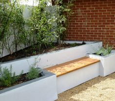 raised beds built in block and rendered with hardwood polished seat area i would love to do something similar in the middle of the garden with a more round area lighting flower bed
