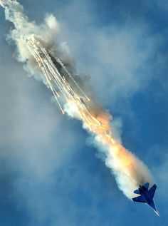A Russian SU-27 combat aircraft performs a stunt during the International Maritime Defence Show in St. Petersburg