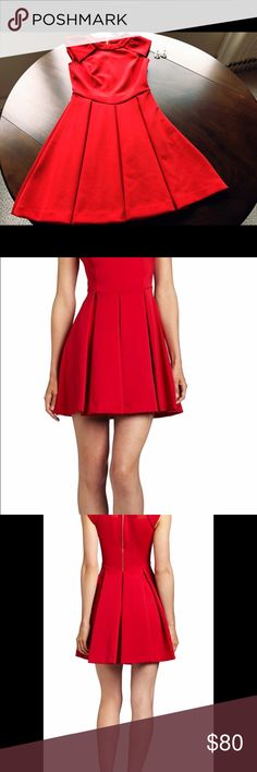Ted Baker Kipp Dress size 1 - US Size 4 Beautiful and fun red dress, perfect any special occasions, I wore this dress sparingly- only twice and unfortunately went up two sizes and can't wear it any more. It's got beautiful rose gold zipper detail in the back. Ted Baker London Dresses