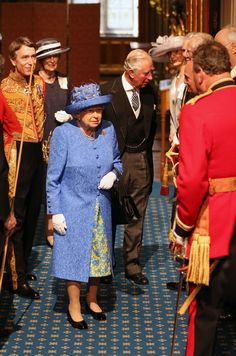 Britain's Queen Elizabeth II (C) and Britain's Prince Charles, Prince of Wales arrive at the Palace of Westminster and the Houses of Parliament from the Norman Porch for the State Opening of Parliament on June 21, 2017 in London, England. This year saw a scaled-back State opening of Parliament Ceremony with the Queen arriving by car rather than carriage and not wearing the Imperial State Crown or the Robes of State.