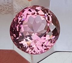 3.90cts, orangish Pink Tourmaline, No Treatment, VVS1 Eye Clean pink gemstone