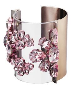 This Christian Dior cuff would give a futuristic feel to a floral feminine outfit