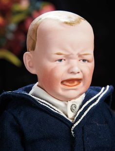Rare German Bisque Crying Character by Gebruder Heubach --closed mouth in sculpted crying expression with defined gums and tongue, kid gusset-jointed body, bisque forearms, antique sailor costume. Condition: generally excellent. Marks: 5 Germany. Comments: Gebruder Heubach, circa 1910.