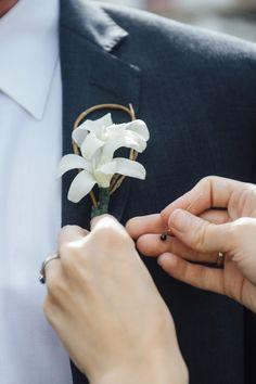 Boutonnieres were pinned to groomsmen's lapels.  Venue/Caterer: Galvez Restaurant  Event Planner:Weddings by Lulu  Groom and Groomsmen Attire: J.Crew  Floral Designer:Erin Steen, Florist