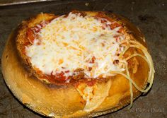 Spaghetti Garlic Bread Bowls  1. Bread Bowls hollowed out  2. Brushed with garlic butter  3. Broiled  4. Layer of thick and meaty sauce (homemade) topped with a layer of pasta  5. Topped with a layer of sauce, cheese  6. Broiled to melt cheese, and ready to eat!