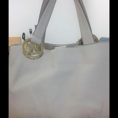 Michael Kors East West Leather Vanilla Tote Double top handles with gold-tone logo charm rings.  MK Rings are placed on EACH side of this handbag.  One zip pocket and four Slip pockets.  Magnetic closure. Michael Kors Bags Totes