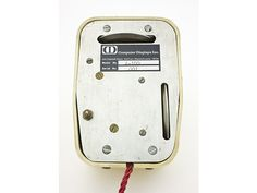 Mouse prototype, 1968.     Early prototype of tree-button mouse.   Copyright© Mark Richards