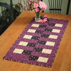 Bricklayers+Daughter+is+a+table+runner+using+strips+sets+cut+into+segments+for+fast+and+easy+construction+without+matching+seams!+Add+segments+or+change+the+border+size+to+create+a+table+runner,+placemats...