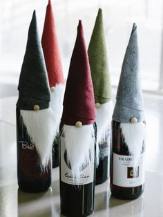 64 Homemade Christmas Gift Ideas DIY Wine Elf - To dress up a bottle of wine as a holiday hostess gift, cut felt into an rectangle and faux fur into a triangle roughly 2 inches wide by 4 inches long. Wrap felt rectangle into a cone shape, securing the Homemade Christmas Gifts, Christmas Holidays, Christmas Wine, Christmas Gnome, Crafty Christmas Gifts, Funny Christmas, Christmas Ideas, Christmas Projects, Christmas Carol