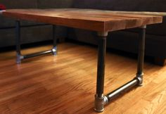 Handmade Wooden Coffee Table with Galvanized Steel Pipe Legs. $200.00, via Etsy.