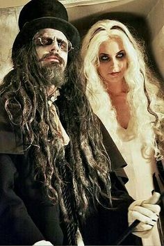 Rob Zombie and Sherry Moon Zombie in Halloween dresses, posing. . . . . #robzombie #sherrymoonzombie #metal #metalmusic #heavymetal #legend #legendary #band #metalhead #rockandroll #rocknroll #hardrock #rockgod #rocker #halloween