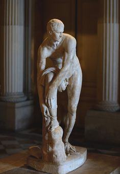 """Hermes fastening his sandal, so-called """"Cincinnatus."""" Pentelic marble. Roman copy of the 2nd cent. CE after a Greek original by Lysippos of the 4th century BCE. Paris, Louvre Museum. www.decorarconarte.com"""
