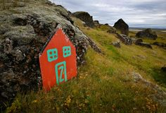 """A painted """"elf door"""" leans against rocks near the Icelandic town of Selfos. How the country's history and geography created the perfect setting for magical creatures, whose perceived existence sparks environmental protests to this day. Iceland Elves, Minibus, Elf Door, Iceland Island, Most Haunted, Construction Worker, Lofoten, Magical Creatures, The Elf"""