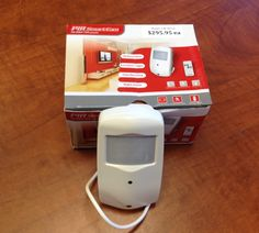 Motion detector with pinhole camera