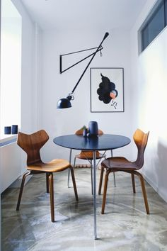 #interior #styling #dining #decor #modern #minimalist #concrete #floor #chairs #pendant #lamp #grey #white #wood #frames #posters #pictures