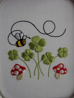Toadstools, bee and clovers