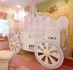 Sweet dreams: This Cinderella carriage-shaped crib from poshtots.com features a changing station on the back and drapes - but at $20,900 it is a fantasy item for most parents