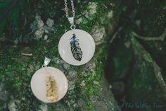 Black feathered goddess pendant