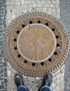 This manhole cover shows famous buildings in Berlin. Check out the cool manhole covers link sent by my sister: Cool Manhole Covers (japanese site) Japanese Site, Berlin, Drain Cover, Famous Buildings, Architectural Features, Ancient Rome, Cover Design, Cover Art, Street Art