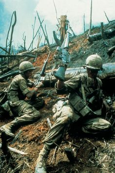 U.S. soldiers fighting on a bombed out hill. ~ Vietnam War