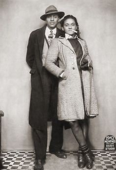 Sharp dressed African American couple sitting for a full length portrait shot taken at the Daisy Studio, located at 315 Beale Street, Memphis, TN, 1942.