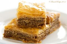 Baklava is a rich, flaky dessert made with layers of nuts sandwiched between layers of thin dough and baked to perfection and then drenched in sugar syrup.