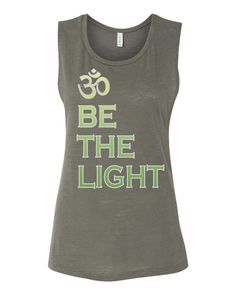 A personal favorite from my Etsy shop https://www.etsy.com/listing/509160594/be-the-light-om-yoga-muscle-tank