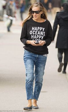 Sarah Jessica Parker in boyfriend jeans, grey flats and G-Star's RAW 'Happy Oceans Happy Life' jumper - designed by Pharrell Williams and made in part from recycled ocean material (retails around $180)