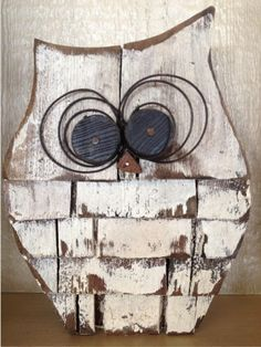 Uil Looks like owl is made from old barn wood. Did a great job.