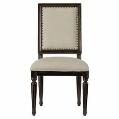 "Fluted side chair with an upholstered back and seat and nailhead trim. Product: Chair  Construction Material: Solid hardwood and fabric Color: Charcoal    Features: Nailhead trim    Dimensions: 40"" H x 21"" W x 22"" D      Note: Assembly required"