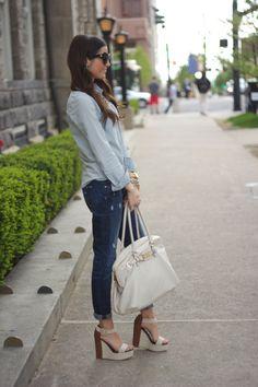 Blue shirt, jeans and high heel espadrillos.