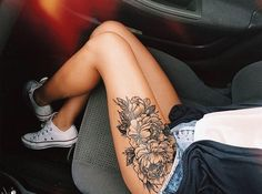 Thigh tattoos.