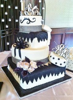 Buttercream iced package cakes with gumpaste bows, roses and callas.  Black fondant trim and bling!