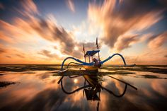 Long exposure of a outrigger boat on a beach in Bali, Indonesia