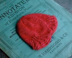 "raspberry red silk baby hat from One Skein - in Lousia Harding 'Grace"" 50 %merino 50% silk...."
