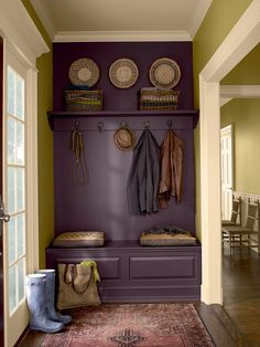 Amazing plum colored wall.  Looks like one piece of furniture, actually it's just a shelf and  storage bench.  ♥ it!!