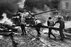 Czech citizens attack a Soviet tank in Prague - August 1968 Marie Curie, War Photography, Street Photography, Prague Spring, Einstein, Warsaw Pact, Photographer Portfolio, First Photograph, Magnum Photos