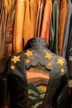 Jo Jo Nouveau Gents 1970's leather bomber jacket with sunset and star detailing.