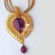Contemporary jewellery designs from NATHELA jewellers. Its a unique kind of ruby pendent along with ear rings. Jewelry Stores Near Me, Ruby Pendant, Gold Pendant, Pendant Set, Pendant Jewelry, Chain Pendants, Pendant Necklace, Gold Jewellery Design, Rings