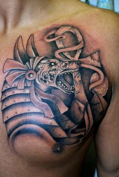 Black anubis with ankh tattoo on chest