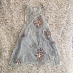 Free People top So so cute! Amazing high neck light blue top with flower details in rose gold sequins. Perfect for layering and a fun too for anyone to wear. Fits slightly small Free People Tops