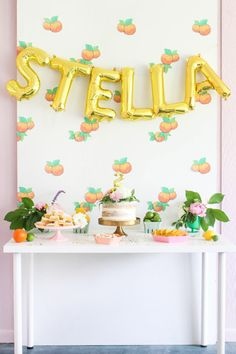 Vintage Citrus Floral Birthday Party -- name balloon banner backdrop