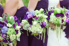 Dark purple dresses with green and purple bouquets