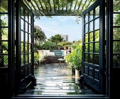 Pergola French doors open onto a lush rooftop garden outfitted with bistro chairs by Fermob at hairstylist Guido Palau's artful Manhattan duplex. Outdoor Seating Areas, Outdoor Rooms, Outdoor Living, Outdoor Decor, Indoor Outdoor, Celebrity Houses, Architectural Digest, French Doors, French Windows