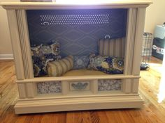 TV console dog bed. Repurposed an old zenith that I picked up for free hand made the pillows and wallpapered the inside