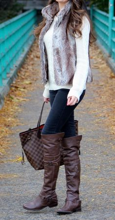 Faux fur vest, louis vuitton neverfull tote bag, over the knee leather boots.