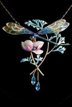 HENRI DUBRET - AN IMPORTANT ART NOUVEAU GOLD, ENAMEL, DIAMOND AND AQUAMARINE PENDANT, CIRCA 1900. Naturalistically designed as a dragonfly atop a flower. Signed H. DUBRET and numbered. 10 x 9.5cm. #Dubret #ArtNouveau