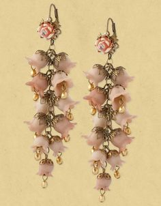 Michal Negrin earrings with vintage flower elements and hyacinth bouquet.