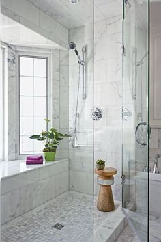 This window bay is lined with marble to be watertight. Privacy film with a frosted look shields bathers from view while allowing light to stream in. | Photo: Stacey Brandford