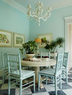 Chiavari chairs and coral chandelier in the breakfast room are unexpected